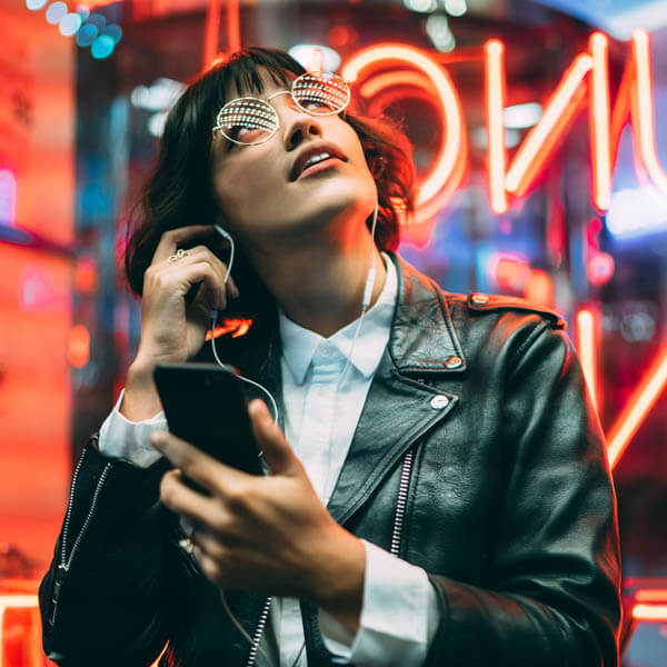 Woman looking at neon lights